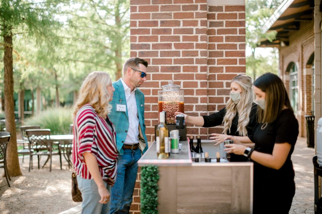 The Willows Event Center team serve drinks at bar during a corporate event